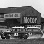 MINI MAGIC! Nothing provoked a bigger smile than Mini-Coopers scrubbing off speed by throwing themselves sideways into corners, humbling bigger machinery. Aintree, 1964