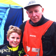 "THE RACING LINE (2). John Surtees, World Champion on two wheels and four, and ""karting dad"" to son Henry, tragically killed in 2009, echoing the dangers of his father's era. Buckmore Park kart circuit 2000"